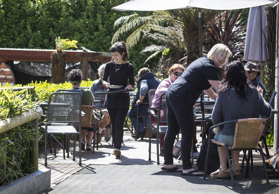 customers dining on cafe terrace