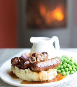 Sausage and mash in front of woodburner