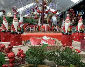 Red Christmas decorations at Trevena Cross 2020